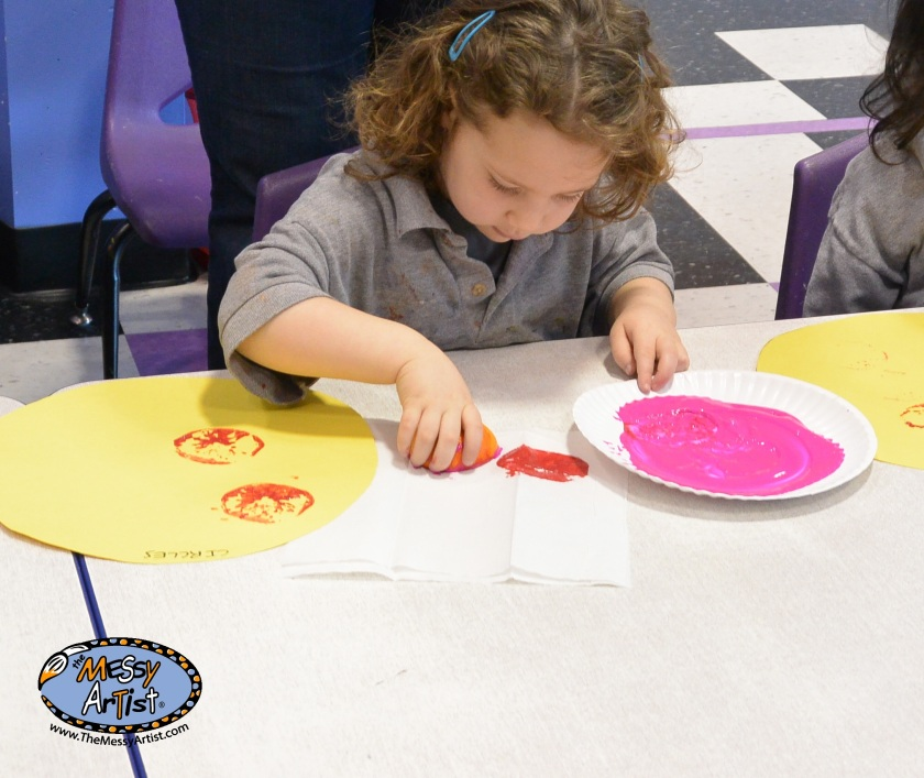 Circle art project - using oranges to print circles on circle shaped paper