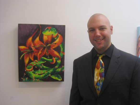 At a gallery exhibit with his artwork