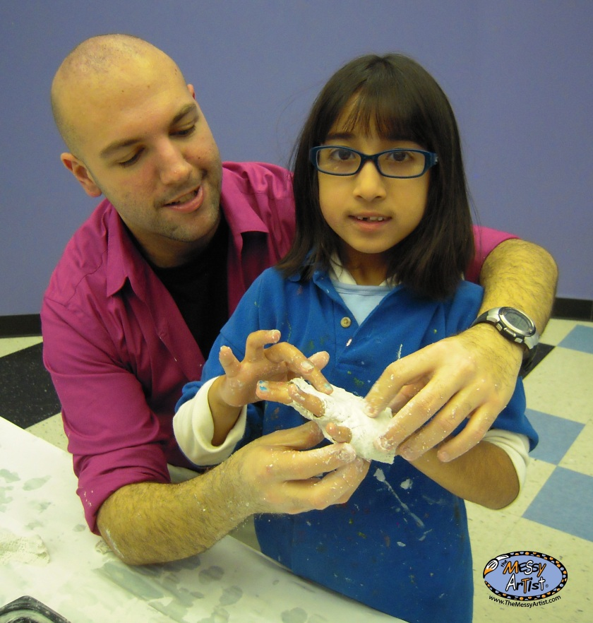 Anthony with a student at Messy Artist