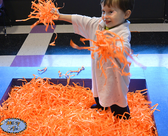 shredded paper sensory play